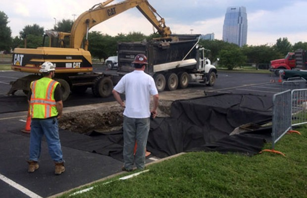 Cracked storm drain causes hole at LP field parking lot