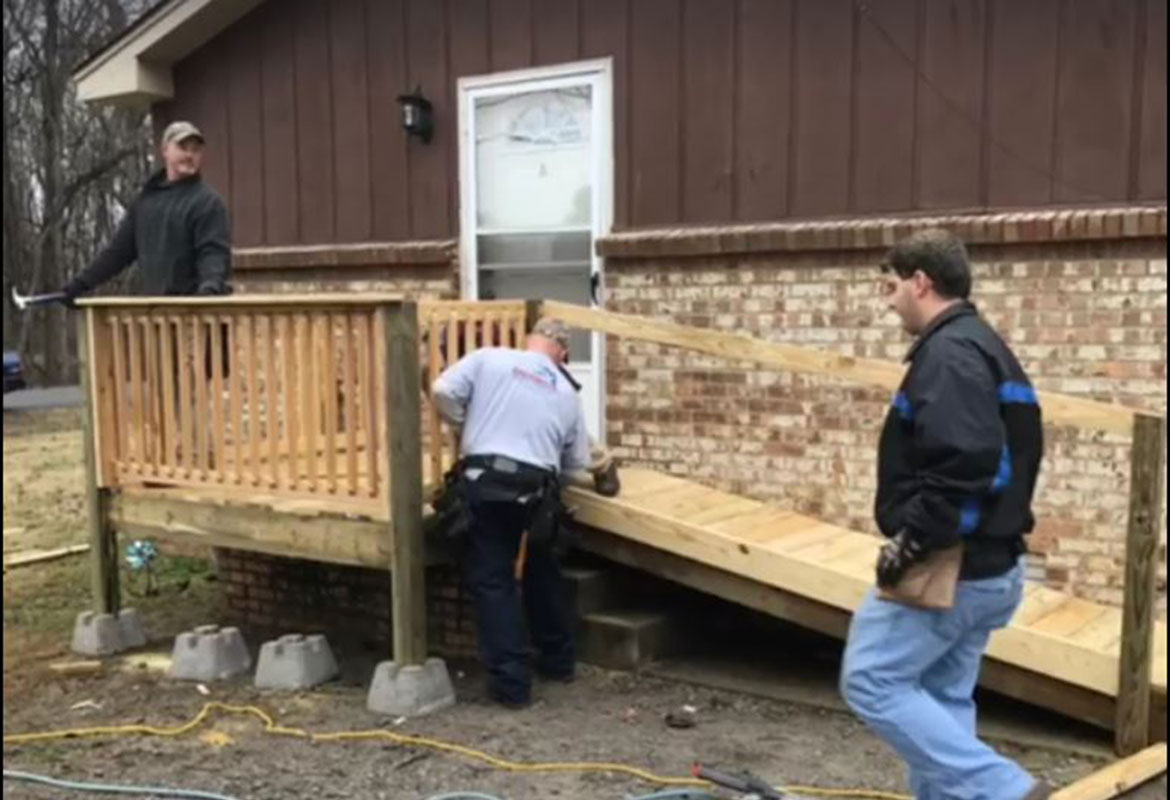 CMCSS Employee Helps Build Wheelchair Ramp For Disabled Student
